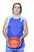 A teenager basketball player over a white background — Stock Photo