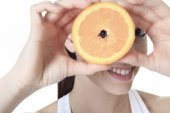 A beautiful training woman with fruit background — Stok fotoğraf