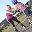 Active family - mother and kid having fun, rollerblading outdoor — Stock Photo #64986151
