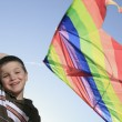 A boy who play with is kite with sky on the background — Stock Photo #64986587