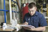 A good serviceman working on a machine room — Stock Photo