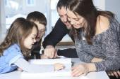 Four member of happy family read story book — Stock Photo