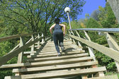 Runner athlete running on stairs. woman fitness jogging workout — Stock Photo