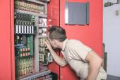 Machinist worker technicians at work adjusting lift with spanner — Stock Photo