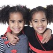 Twin adorable african little girl with beautiful hairstyle isola — Stock Photo #65219133