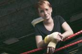 Fitness woman doing punching exercises in training place — Stock Photo