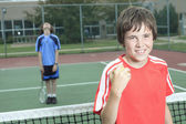 Boy tennis player learning how to preparing to play tennis — Stock Photo