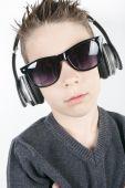 Young boy wearing headphones listening music in studio. — Foto Stock