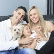 A Family with pets sit on sofa at home — Stock Photo #65224615