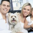 A Family with pets sit on sofa at home — Stock Photo #65224627