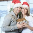 A Christmas Couple wearing Santas Hats. Smiling Family Celebrat — Stock Photo #65225983