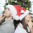 A Christmas Couple wearing Santas Hats. Smiling Family Celebrat — Stock Photo #65226021