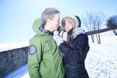 A Happy winter  couple.  in snowy forest. — Foto de Stock