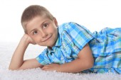 Young Boy Lying down in Studio — Stock Photo