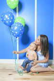 A Boy with colorful balloons in is bedroom — Stock Photo