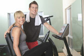 Young athletic couple in gym on training — Stock Photo