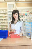 A Woman pharmacist at the pharmacy place — Stock Photo