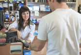 A Pharmacist helping customer at counter place — Stockfoto