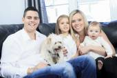 A Family with pets sit on sofa at home — Foto de Stock