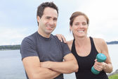 A Young, caucasian couple working out with dumbbells outside — Stock Photo