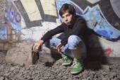 A teen made some graffiti on the wall of a tunnel — Stock Photo