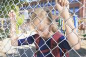 A sad little girl at school playground — Stock Photo