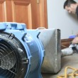 A Ventilation cleaner working on a air system. — Stock Photo #65232109
