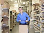 A Pretty warehouse manager checking the inventory — Stock Photo