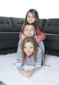 A happy family on the floor of the living room — Stock Photo