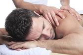 Man receiving Shiatsu massage from a professional masseur at spa — Stock Photo