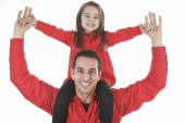 A happy family member. A father with daughter on his shoulder. — Stock Photo