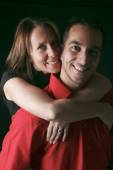 A 30 years old couple in front of black background — Stock Photo