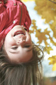 Upside down girl in autumn background — Stock Photo
