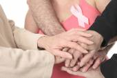 A woman holding a breast cancer logo — Stock Photo