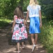 Two young children walking on path holding hands — Stock Photo #65380601