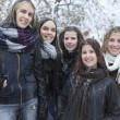 A Group of excited young girl friends outdoors in winter — Stock Photo #65382411
