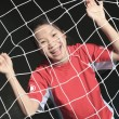 A female soccer player in a stadium — Stock Photo #65387683
