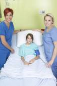 Little girl in hospital bed with the nurse — Stock Photo