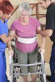 Elderly lady with her physiotherapists in a hospital — Stock Photo