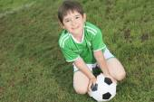 Kid play soccer on a field — Stock Photo