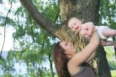 A mother with is baby on a beautiful forest — Stock Photo