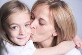 A mother with is daughter over gray background — Stock Photo