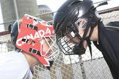 A Portrait of hockey ball player with hockey stick — Stock Photo