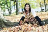 A beautiful autumn woman having good time. — Stock Photo