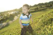 A little boy at the sunset in a field — Stock Photo