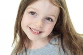Close-up portrait of a beautiful little girl on white background — Foto de Stock