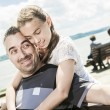 Father with his daughter at sea getting good time — Stock Photo #76717751