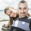 Father with his daughter at sea getting good time — Stock Photo #76718335