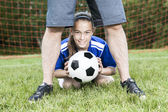 Teenager girl with his father play soccer in a beautiful day — Stock Photo