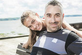Father with his daughter at sea getting good time — Stock Photo